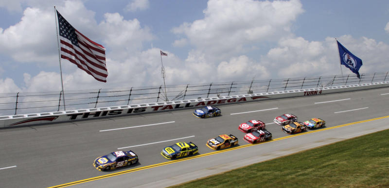 Martin Truex Jr (56) leads a pack of cars through Turn 4 during NASCAR auto racing practice at the Talladega Superspeedway in Talladega, Ala., Friday, May 4, 2012. (AP Photo/Butch Dill)