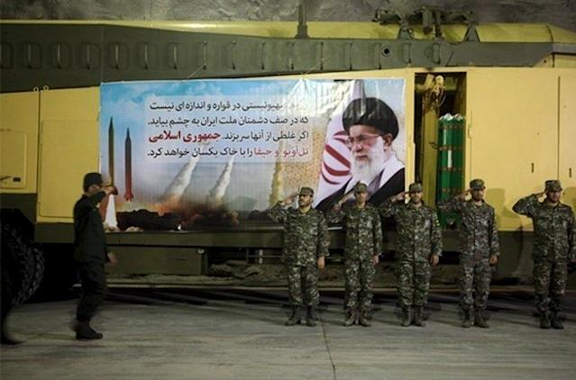 Members of Iran's Islamic Revolutionary Guard Corps (IRGC) Aerospace Force salute at an underground missile base. REUTERS/farsnews.com/Handout via Reuters