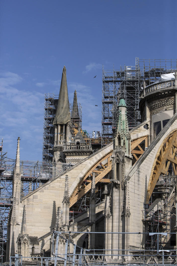 Workers are pictured during preliminary work to repair the fire damage at the Notre-Dame de Paris Cathedral, in Paris, France, Wednesday, July 24, 2019. (AP Photo/Rafael Yaghobzadeh, Pool)