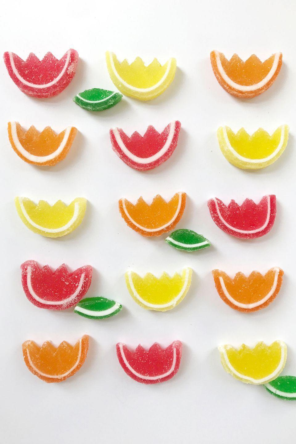 """<p>""""It doesn't take much to turn traditional fruit slices into spring table decor! Just cut a zigzag shape into the top of each one and voilà—instant flowers! They can be set out in small bowls on your table, set out on a tray, or placed on a cake as a sweet floral topper."""" <em>—<a href=""""http://www.darcymillerdesigns.com/"""" rel=""""nofollow noopener"""" target=""""_blank"""" data-ylk=""""slk:Darcy Miller"""" class=""""link rapid-noclick-resp"""">Darcy Miller</a>, Author and Entertaining Expert</em></p>"""