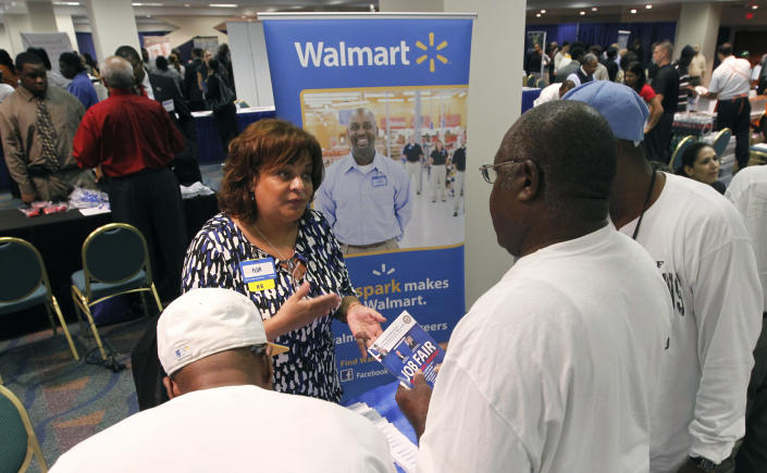 Job candidates receive information about employment at Walmart at a U.S. Congressional Black Caucus Jobs Fair in Miami, Florida August 23, 2011.  REUTERS/Joe Skipper  (UNITED STATES - Tags: EMPLOYMENT BUSINESS)