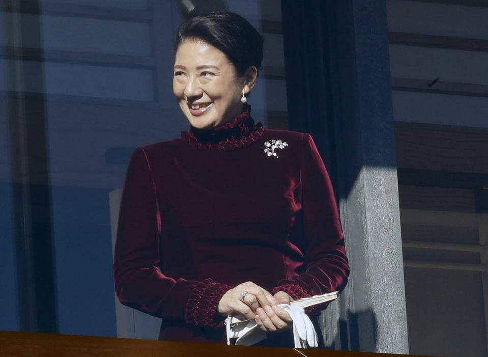 Japan's Crown Princess Masako smiles from the balcony during the New Year's public appearance to well-wishers with Japan's Emperor Akihito's family members at Imperial Palace in Tokyo Wednesday, Jan. 2, 2019. Akihito waved Wednesday to throngs of well-wishers eager to see the final New Year's appearance in his reign. (AP Photo/Eugene Hoshiko)