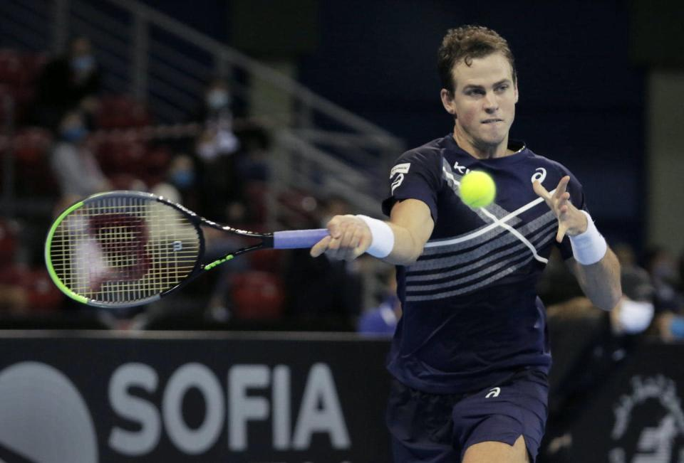 """<span class=""""caption"""">Canada's Vasek Pospisil returns a shot to Italy's Jannik Sinner, during the final match of the 2020 Sofia Open on Nov. 14, 2020.</span> <span class=""""attribution""""><span class=""""source"""">(AP Photo)</span></span>"""