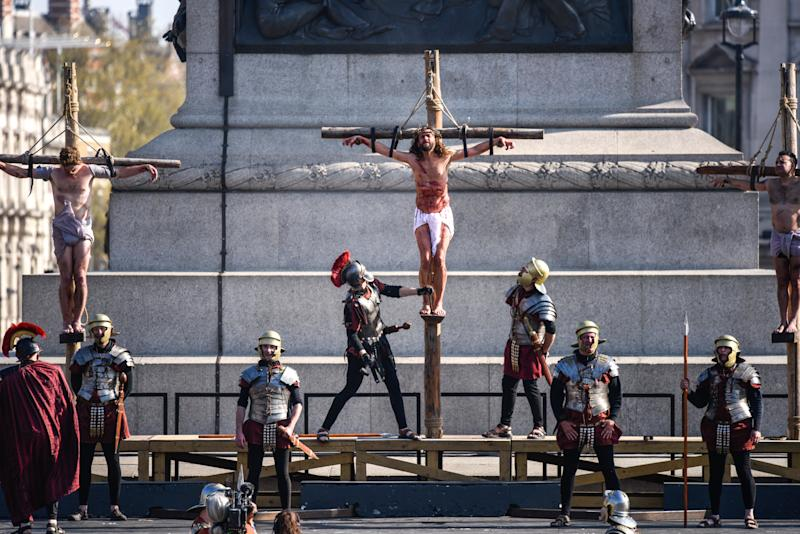 Actors reenact the crucifixion in front of crowds in Trafalgar Square on Good Friday. (Peter Summers via Getty Images)