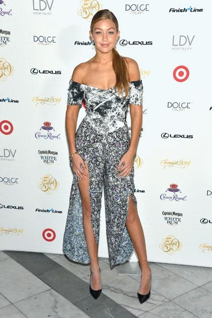 Drop earrings and simple black pumps are the only accessories needed to complete this look thanks to the leg-baring slits of this printed jumpsuit. Gigi has clearly learned when less is more.