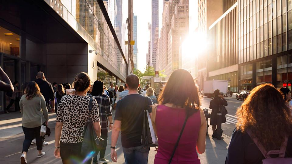 people in New York walking home from work