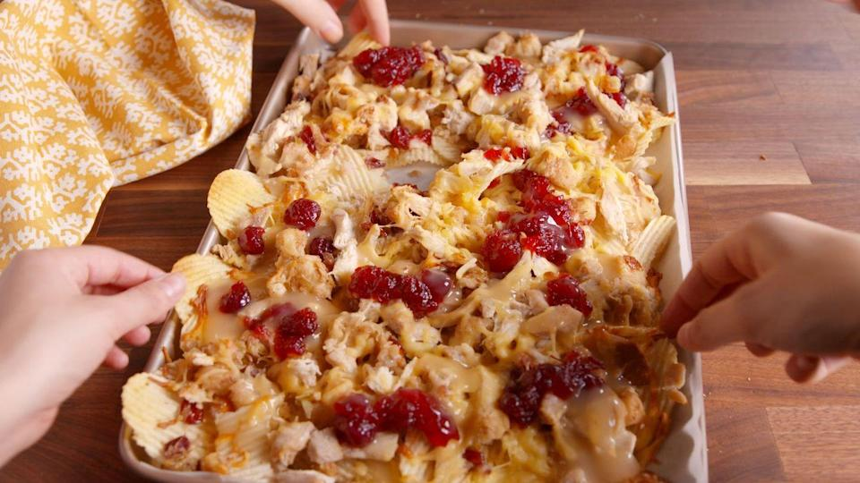 """<p>Top potato chips with leftover stuffing — along with cheese and shredded turkey — for the perfect post-Turkey Day party app.</p><p><em><a href=""""https://www.delish.com/cooking/recipe-ideas/recipes/a50081/friendsgiving-nachos-recipe/"""" rel=""""nofollow noopener"""" target=""""_blank"""" data-ylk=""""slk:Get the recipe from Delish »"""" class=""""link rapid-noclick-resp"""">Get the recipe from Delish »</a></em> </p>"""