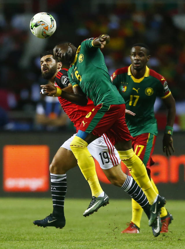 Football Soccer - African Cup of Nations - Final - Egypt v Cameroon - Stade d'Angondjé - Libreville, Gabon - 5/2/17 Cameroon's Ambroise Oyongo in action with Egypt's Abdallah El Said Reuters / Amr Abdallah Dalsh Livepic