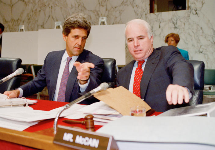 Sen. John Kerry, D-Mass, left, chairman of the Senate POW/MIA Committee, confers with McCain on Capitol Hill on June 24, 1992. (Photo: John Duricka/AP)