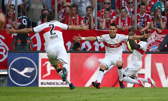 Soccer Football - Bundesliga - Bayern Munich v VfB Stuttgart - Allianz Arena, Munich, Germany - May 12, 2018 Stuttgart's Chadrac Akolo celebrates scoring their third goal with Erik Thommy and Emiliano Insua REUTERS/Michael Dalder DFL RULES TO LIMIT THE ONLINE USAGE DURING MATCH TIME TO 15 PICTURES PER GAME. IMAGE SEQUENCES TO SIMULATE VIDEO IS NOT ALLOWED AT ANY TIME. FOR FURTHER QUERIES PLEASE CONTACT DFL DIRECTLY AT + 49 69 650050