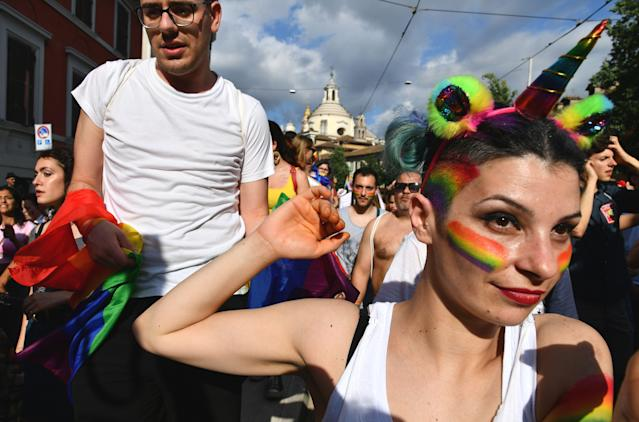 <p>Revellers take part at the Gay Pride Parade in downtown Rome on June 9, 2018. (Photo: Vincenzo Pinto/AFP/Getty Images) </p>