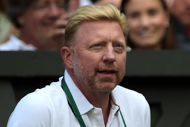 Boris Becker watches Novak Djokovic's third round match against Gilles Simon during the Wimbledon Championships at The All England Tennis Club in southwest London, on June 27, 2014 (AFP Photo/Carl Court)