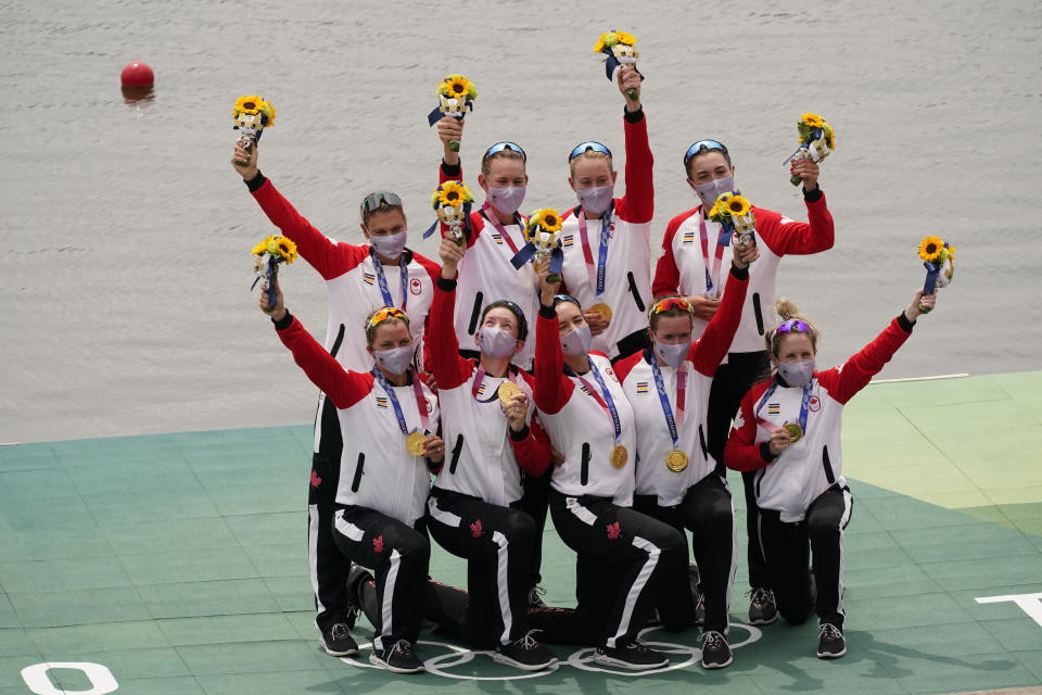 Lisa Roman, Kasia Gruchalla-Wesierski, Christine Roper, Andrea Proske, Susanne Grainger, Madison Mailey, Sydney Payne, Avalon Wasteneys and Kristen Kit of Canada celebrate winning the gold medal in the women's rowing eight final at the 2020 Summer Olympics, Friday, July 30, 2021, in Tokyo, Japan. (AP Photo/Darron Cummings)