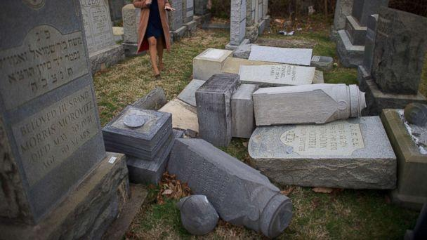 PHOTO: A television reporter broadcasts in front of vandalized Jewish tombstones at Mount Carmel Cemetery Feb. 27, 2017 in Philadelphia. (Mark Makela/Getty Images)
