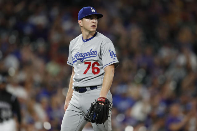 Los Angeles Dodgers relief pitcher Josh Sborz reacts after giving up a two-run home run to Colorado Rockies' David Dahl in the eighth inning of a baseball game Monday, July 29, 2019, in Denver. (AP Photo/David Zalubowski)