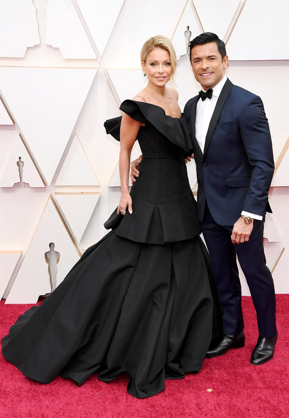 """The """"Live with Kelly and Ryan"""" host in Christian Siriano and her """"Riverdale"""" actor husband were one of the first stars to arrive on the Oscar red carpet."""