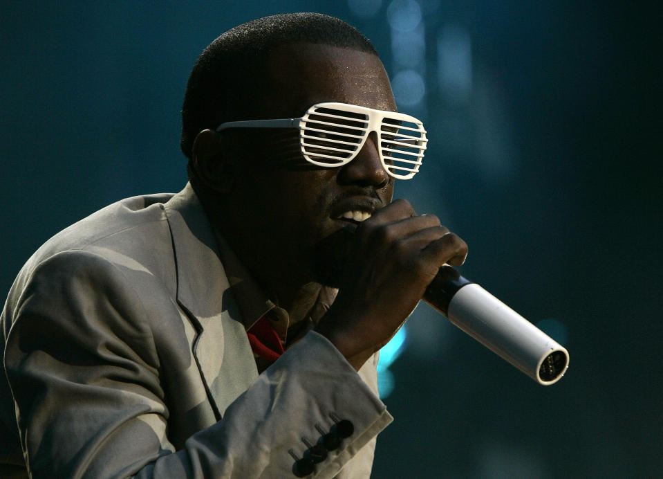 Kanye West performs during the Concert for Diana at Wembley Stadium in London July 1, 2007. An international lineup of pop stars paid tribute to Princess Diana on Sunday at a memorial concert watched by her sons Princes William and Harry and a crowd of 60,000 at London's Wembley Stadium. REUTERS/Luke MacGregor    (BRITAIN)