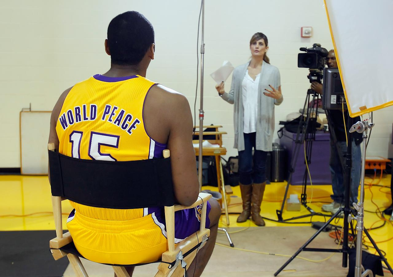 EL SEGUNDO, CA - DECEMBER 11:  Metta World Peace #15 receives instructions while being interviewed during Los Angeles Lakers Media Day at Toyota Sports Center on December 11, 2011 in El Segundo, California.  (Photo by Jeff Gross/Getty Images)