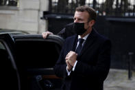 French President Emmanuel Macron greets Austrian ambassador Michael Linhart , who has gone into self-isolation after coming into contact with a person who has tested positive for COVID-19, after signing a condolence book for victims of the Vienna attack, at the Austrian embassy to France in Paris, Tuesday, Nov. 3 2020. French President Emmanuel Macron signed a condolence book at the Austrian Embassy in Paris on Tuesday, in French and German. (Christophe Petit Tesson, Pool via AP)