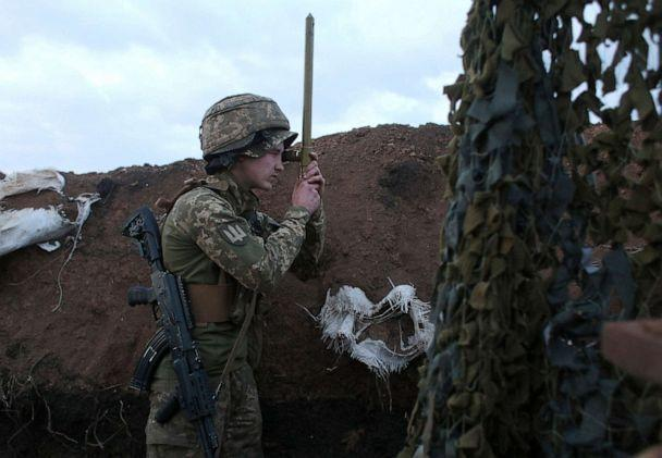 PHOTO: A Ukrainian serviceman uses a periscope in a trench as he stands at his post on the frontline with Russia backed separatists near the town of Zolote, in the Lugansk region on April 8, 2021. (AFP via Getty Images)