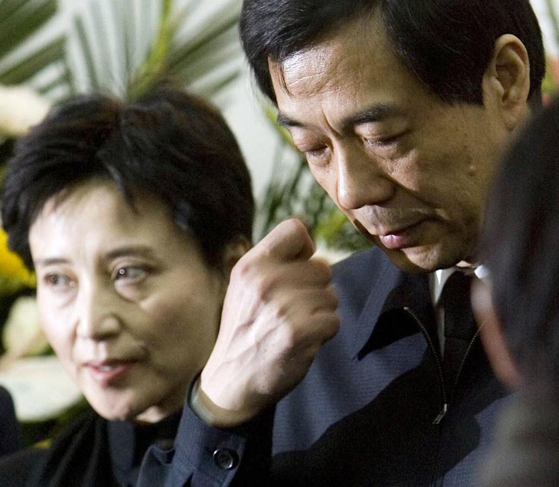 FILE - In this Jan. 17, 2007 file photo, former Chongqing Communist Party Secretary Bo Xilai, right, accompanied by his wife Gu Kailai, attends a funeral for his father in Beijing. Chinese prosecutors were charging Gu and a family aide with the murder of a British businessman, the official Xinhua News Agency reported Thursday, July 26, 2012. (AP Photo/Kyodo News/China Foto Press) JAPAN OUT, MANDATORY CREDIT, NO LICENSING IN CHINA, HONG KONG, JAPAN, SOUTH KOREA AND FRANCE, NO SALES