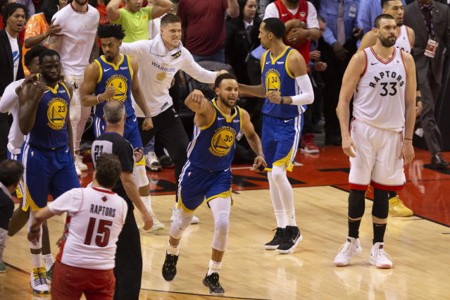 The Warriors' Stephen Curry (30) celebrates at the final buzzer as Golden State defeats the Toronto Raptors 106-105 in Game 5 of the NBA Finals in Toronto on Monday. (Chris Young/The Canadian Press via AP)