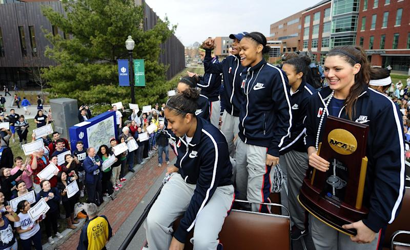 From left, Connecticut's Kaleena Mosqueda-Lewis,Brianna Banks, Moriah Jefferson and Stefanie Dolson sit atop a double-decker bus during a parade through campus honoring the team's win in the women's NCAA Final Four college basketball championship in Storrs, Conn., Wednesday, April 10, 2013. (AP Photo/Jessica Hill)