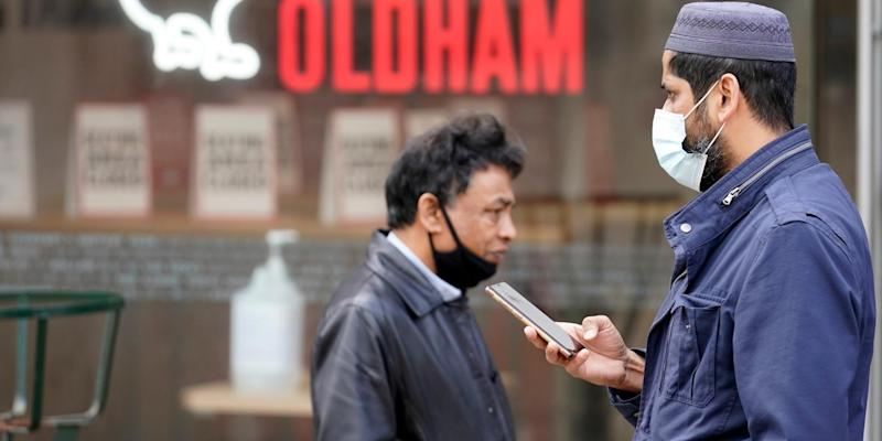People wear face masks as they go about their daily lives Oldham, Manchester on July 29, 2020: Getty Images