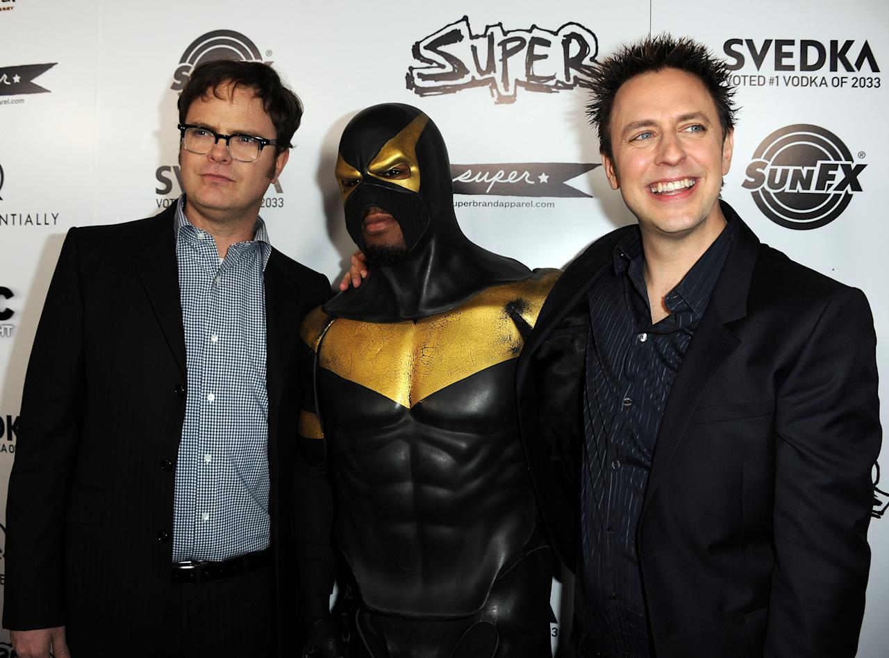 "HOLLYWOOD, CA - MARCH 21:  (L-R) Actor Rainn Wilson, superhero Phoenix Jones, and director James Gunn arrive at the premiere of IFC Midnight's ""Super"" at the Egyptian Theatre on March 21, 2011 in Hollywood, California.  (Photo by Kevin Winter/Getty Images)"