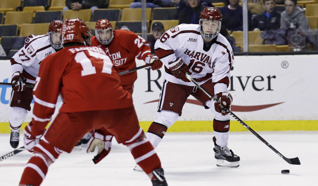 FILE- In this Feb. 5, 2018, file photo, Harvard forward Ryan Donato (16) looks to pass against Boston University during the second period of the first round of the Beanpot hockey tournament in Boston. The Boston Bruins have signed Donato to a two-year entry-level deal and say the U.S. Olympic star could play as soon as Monday, March 19, 2018. (AP Photo/Charles Krupa, File)
