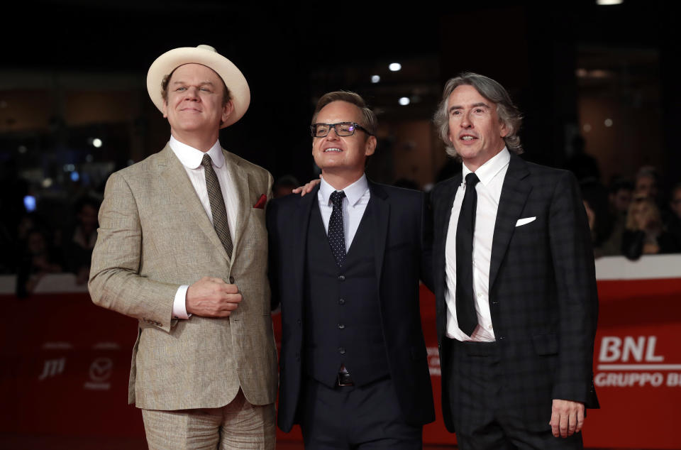 "Actors John C. Reilly, left, and Steve Coogan right, pose with director Jon S. Baird during the red carpet of the movie ""Stan & Ollie"", at the 13th edition of the Rome Film Fest, Wednesday, Oct. 24, 2018. (AP Photo/Alessandra Tarantino)"