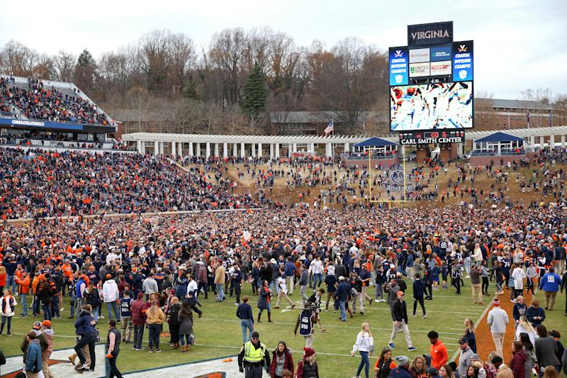 CHARLOTTESVILLE, VA - NOVEMBER 29: Fans of the Virginia Cavaliers rush the field after defeating the Virginia Tech Hokies during a game at Scott Stadium on November 29, 2019 in Charlottesville, Virginia. (Photo by Ryan M. Kelly/Getty Images)