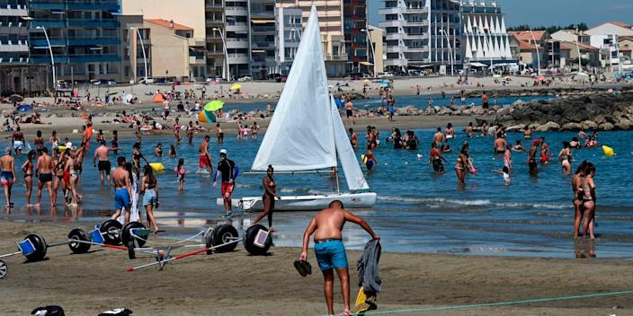 """People cool off in the sea during a heatwave at a beach in Palavas-les-Flots, southern France, on June 23, 2020 as France eases lockdown measures taken to curb the spread of the Covid-19 pandemic <p class=""""copyright"""">PASCAL GUYOT/AFP via Getty Images</p>"""