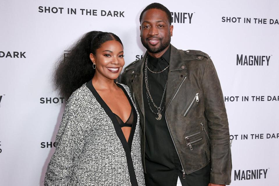 WEST HOLLYWOOD, CA - FEBRUARY 15:  Gabrielle Union (L) and Dwyane Wade attend Magnify and Fox Sports Films'