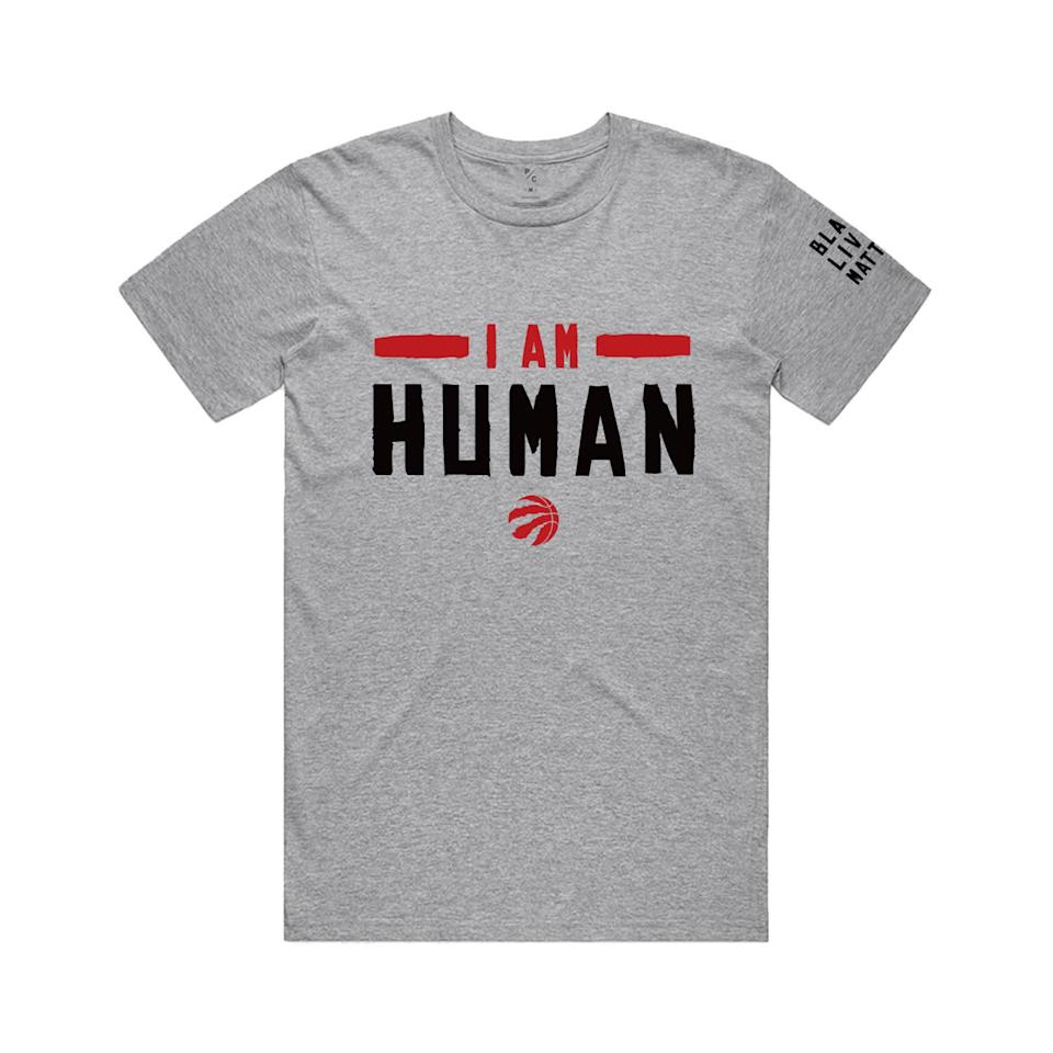 """A grey shirt that reads """"I am human"""", with """"Black Lives Matter"""" on the right sleeve."""