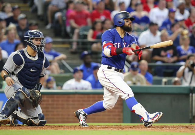 Texas Rangers Rougned Odor (12) watches the ball after hitting a 3 run home run to tie the game against the New York Yankees in the fourth inning of a baseball game Monday, May 21, 2018, in Arlington, Texas. (AP Photo/Richard W. Rodriguez)