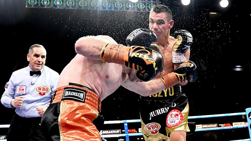 Seen here, Tim Tszyu hits Jeff Horn with a powerful right hand.