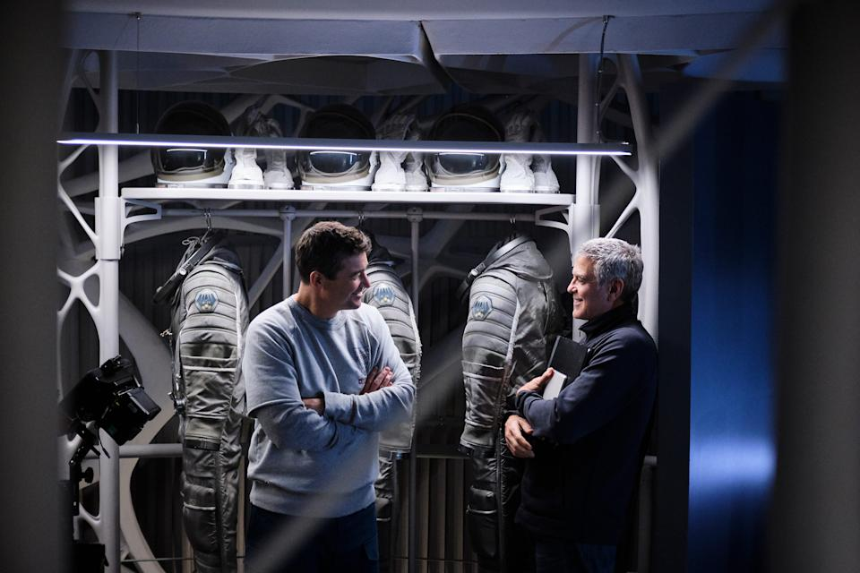 """Kyle Chandler and director George Clooney enjoy a moment on the spaceship set of """"The Midnight Sky."""""""