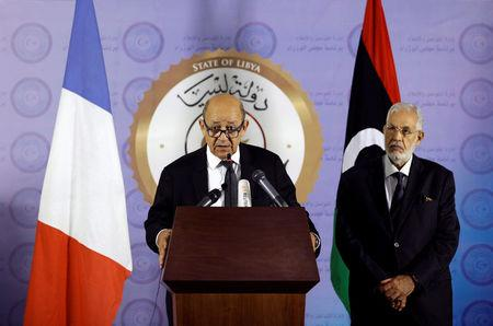French Foreign Affairs Minister Jean-Yves Le Drian (L) speaks during a news conference at the headquarters of the prime minister's office in Tripoli, Libya September 4, 2017 . REUTERS/Ismail Zitouny.