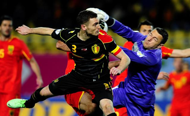 FILE - ThisFriday, March 22, 2013 file photo shows Belgium's Thomas Vermaelen, left,as he jumps for the ball with Macedonia's goalkeeper Tome Pacovski, right, during their World Cup 2014 Group A qualifying soccer match, at Philip II arena in Skopje, Macedonia. (AP Photo/Boris Grdanoski, File)