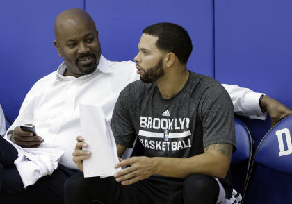 Could GM Billy King (left) have his eye on a point guard to replace Deron Williams? (AP/Gerry Broome)
