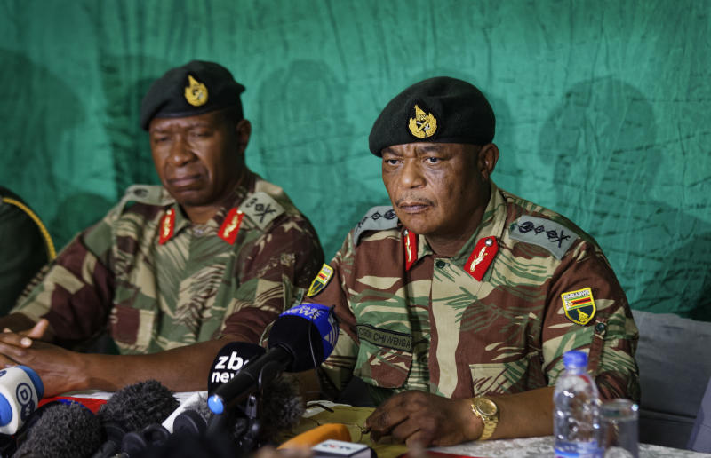 <p> Zimbabwean Army General Constantino Chiwenga, right, speaks to the media at KG6 barracks in Harare, Zimbabwe Monday, Nov. 20, 2017. The military has had President Robert Mugabe under house arrest for several days, and urged for calm. (AP Photo/Ben Curtis) </p>