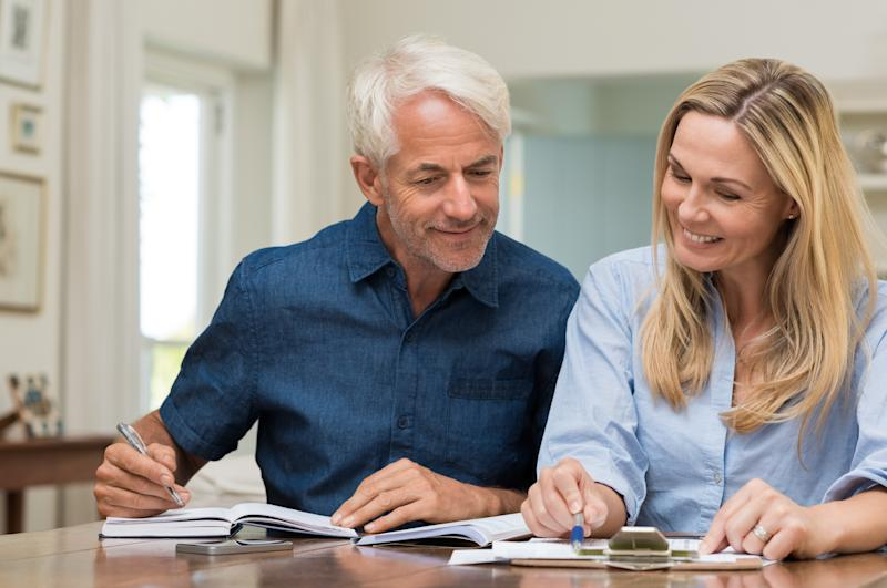 Mature couple happily discussing finances