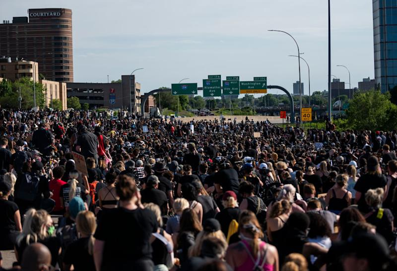 A large crowd of protesters on the I-35W bridge in Minneapolis. Source: Getty Images