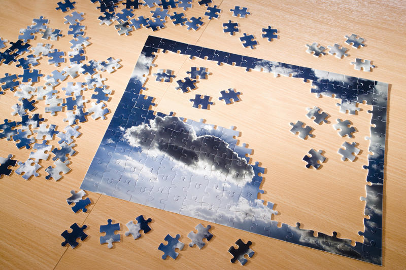 Completing puzzles, exercising and reading can help alleviate feelings of isolation and boredom during quarantine. (Image via Getty Images)