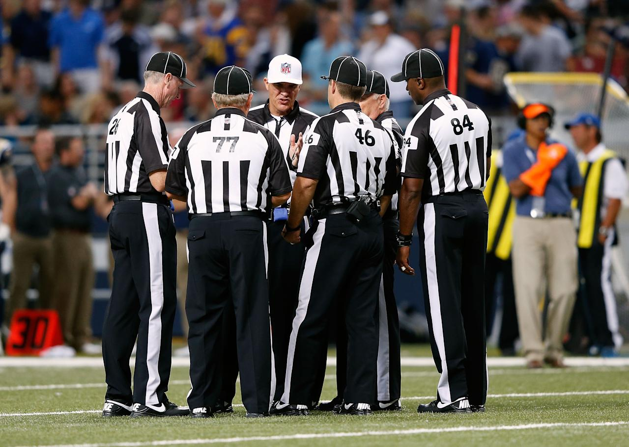 ST LOUIS, MO - SEPTEMBER 16: Replacement referees huddle during a timeout in the game between the Washington Redskins and the St. Louis Rams at Edward Jones Dome on September 16, 2012 in St Louis, Missouri. (Photo by Jamie Squire/Getty Images)