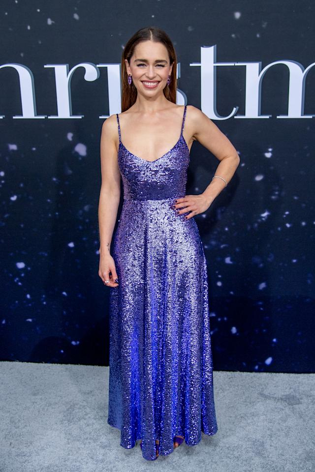 Emilia shone in a sparkly violet number by Valentino. [Photo: Getty]