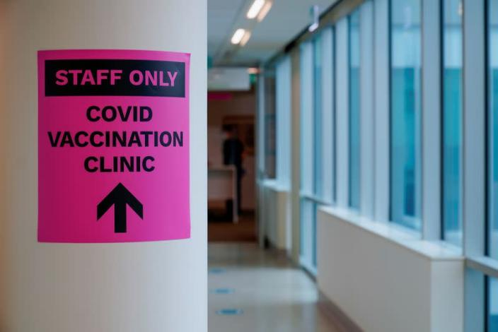 FILE PHOTO: A sign for a COVID-19 vaccination clinic is seen in Melbourne