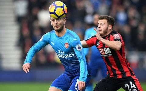 Arsenal's Jack Wilshere in action with Bournemouth's Ryan Fraser - Credit: Reuters