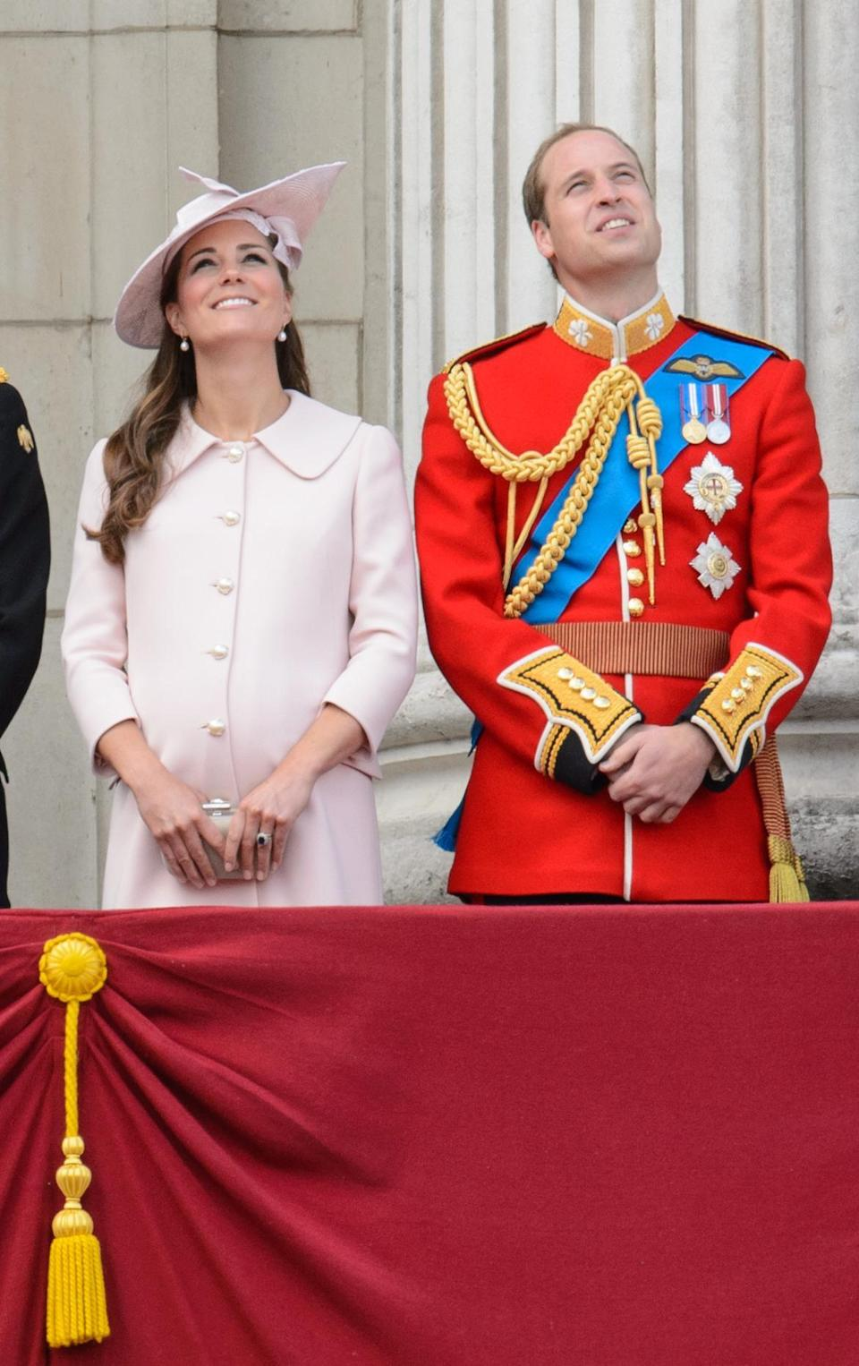 <p>Kate was in a custom pink coat dress by Alexander McQueen for the Queen's Birthday Parade. She accessorised with a matching hat by Jane Corbett, pearl earrings and a grey McQueen clutch. </p><p><i>[Photo: PA]</i></p>